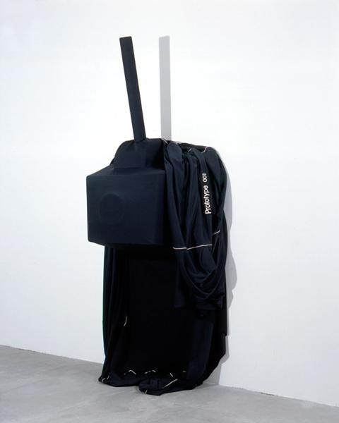 BLACK COVER PROTOTYPE 001<BR />2002<BR />TISSUS, BRODERIE, MOUSSE, RÉSINE, PVC<BR />DIMENSIONS VARIABLES